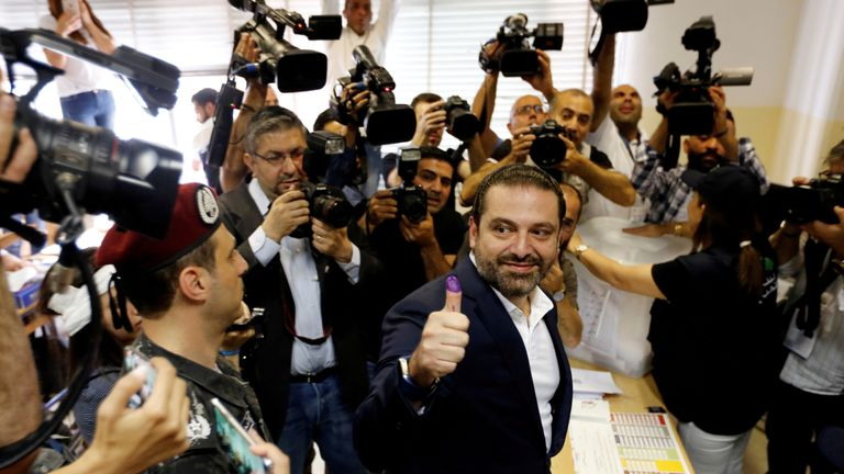 Lebanese prime minister and candidate for the parliamentary election Saad al-Hariri shows his ink-stained finger after casting his vote during the parliamentary election in Beirut, Lebanon, May 6, 2018. REUTERS/Jamal Saidi TPX IMAGES OF THE DAY