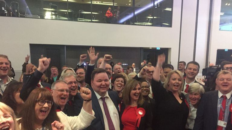 Labour councillors in Trafford celebrate as the Conservatives lose overall control