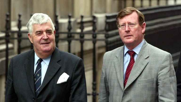 LONDON, UNITED KINGDOM: Northern Ireland Prime Minister David Trimble (R) arrives in Downing Street in London, Tuesday 08 October 2002, with Lord Kilclooney, for crisis talks at No.10