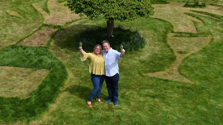 Sue Richards, 51, and 58-year-old Barry Maddox in their garden
