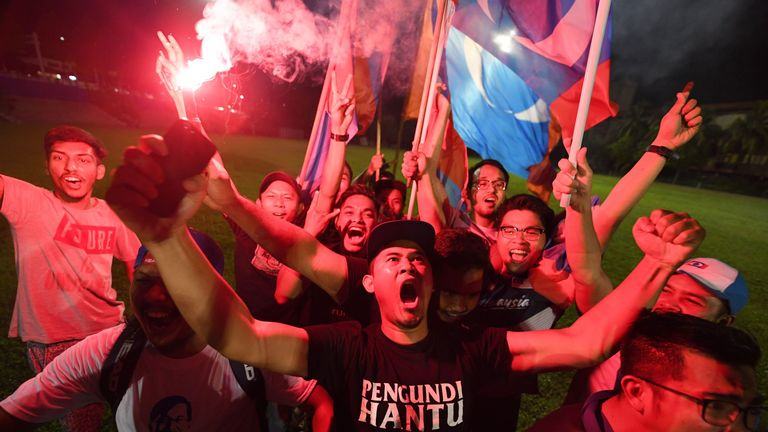 Mahathir Mohamad supporters celebrated in the streets after the 92-year-old's victory