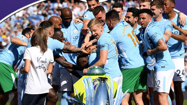 Manchester City's players knocked to trophy over as they celebrated winning the title