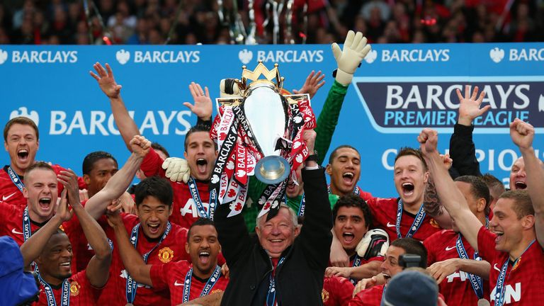 Manchester United Manager Sir Alex Ferguson lifts the Premier League trophy following the Barclays Premier League match between Manchester United and Swansea City at Old Trafford on May 12, 2013