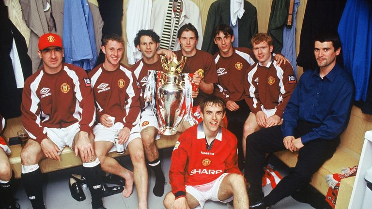 Eric Cantona, Nicky Butt, Ryan Giggs, David Beckham, Gary Neville, Paul Scholes, Roy Keane and Phil Neville of Manchester United celebrate in the dressing room with the FA Carling Premiership trophy after the match between West Ham United v Manchester United at Upton Park on May 11, 1997 in London. Manchester United 2 West Ham United 0. (Photo by John Peters/Manchester United via Getty Images)
