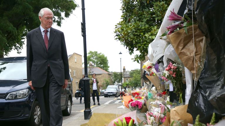 The head of the inquiry Sir Martin Moore-Bick looks at tributes to the Grenfell victims