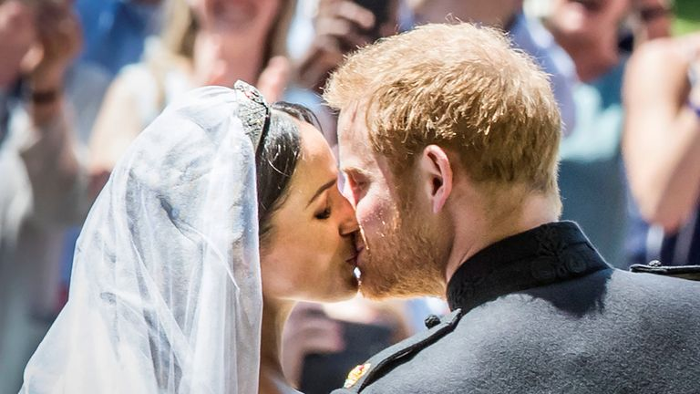 Meghan Markle and Prince Harry kiss on the steps of St George's Chapel