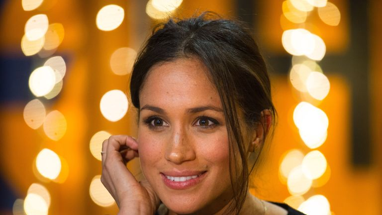 Britain's Prince Harry's fiancée US actress Meghan Markle gestures during a visit to Reprezent 107.3FM community radio station in Brixton, south west London on January 9, 2018. / AFP PHOTO / POOL / Dominic Lipinski (Photo credit should read DOMINIC LIPINSKI/AFP/Getty Images)