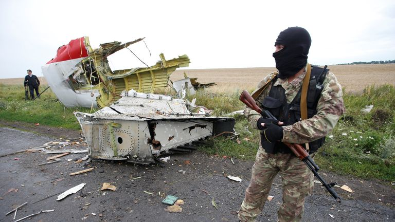 A pro-Russian separatist stands at the crash site of Malaysia Airlines flight MH17, near the village of Hrabove (Grabovo) in Donetsk region, Ukraine