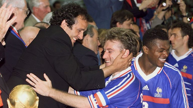 Michel Platini presenting France captain Didier Deschamps with the World Cup in 1998