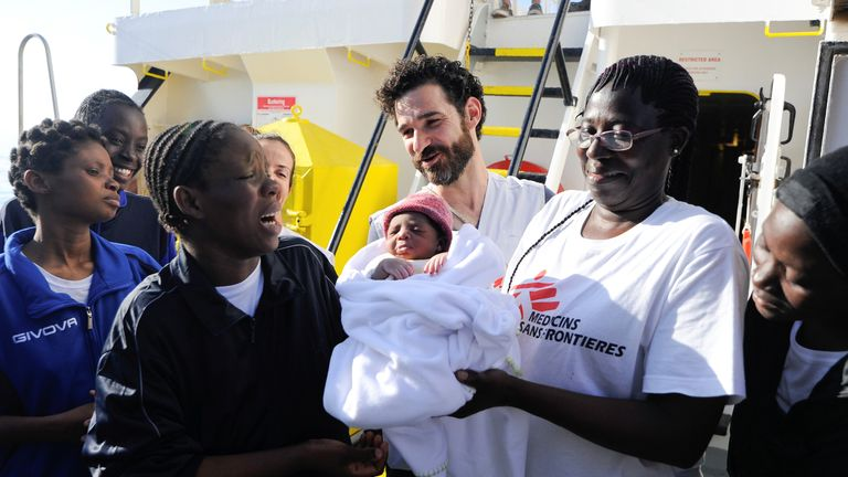 The new mother (L) with her baby and MSF staff