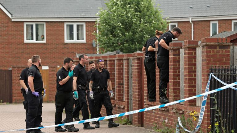 A 28-year-old man has been arrested on suspicion of the murder of the woman and the girl