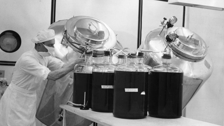 Workers at Glaxo in Buckinghamshire prepare a vaccine based on killed polio virus in 1956