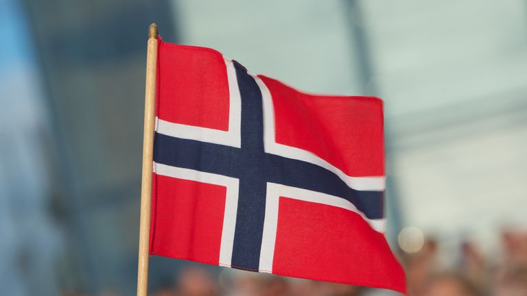 OSLO, NORWAY - MAY 31: A Norwegian flag is seen on the occasion of King Harald and Queen Sonja of Norway's 75th birthday celebration at Oslo Opera House on May 31, 2012 in Oslo, Norway. (Photo by Ragnar Singsaas/Getty Images)
