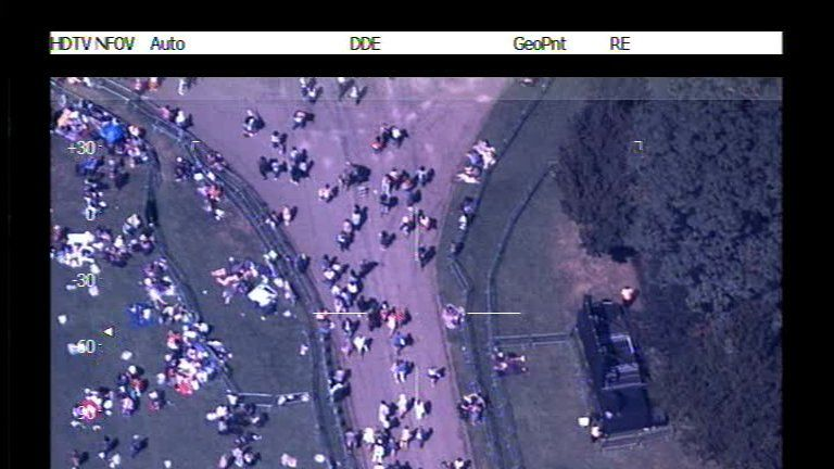 Seconds before the plane came into view the unsuspecting cameraman was checking the Windsor crowds. Pic: NPAS Benson