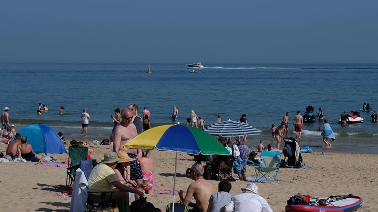 People enjoying the sunshine at Branksome Beach, Poole, as sun worshippers are set to sizzle in the spring heatwave, with Bank Holiday Monday forecast to be the hottest since records began. PRESS ASSOCIATION Photo. Picture date: Sunday May 6, 2018. See PA story WEATHER Hot. Photo credit should read: Martin Keene/PA Wire