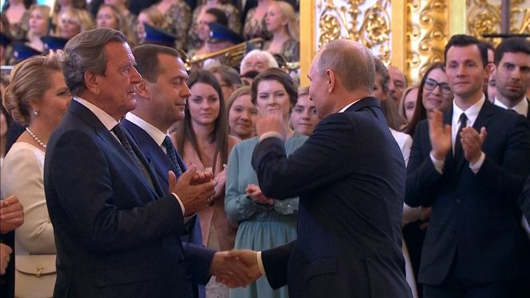 Putin shakes the hand of prime minister Medvedev