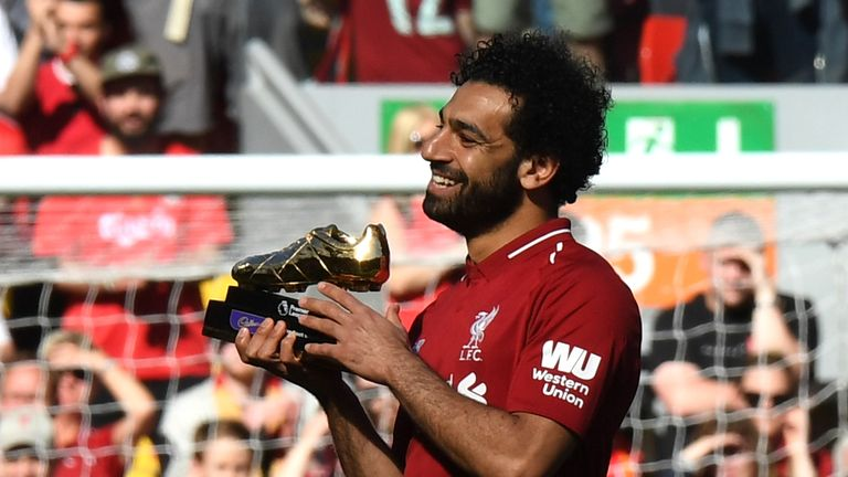 Salah celebrates after being awarded the golden boot award