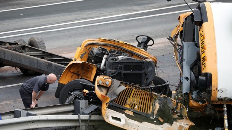 Inspectors look at the wreckage of a bus crash in New Jersey