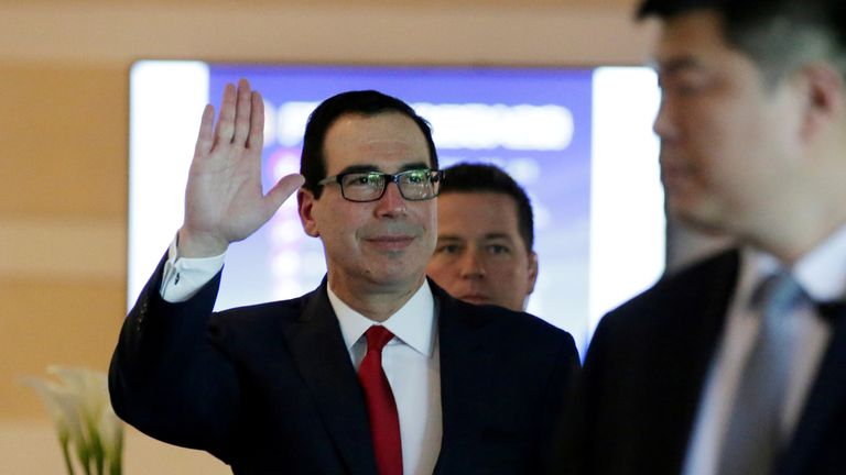 U.S. Treasury Secretary Steven Mnuchin waves to the media as he and the U.S. delegation for trade talks with China, leave a hotel in Beijing, China May 3, 2018.
