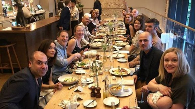 A picture of the Suits cast and crew at a restaurant ahead of the royal wedding