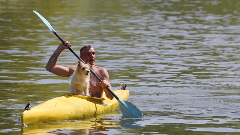 Veron Pimm, accompanied by his canine passenger Bibi, kayaks along the River Thames close to Boulter's Lock in Maidenhead Riverside, Berkshire. Sun worshippers are set to sizzle in the spring heatwave, with Bank Holiday Monday forecast to be the hottest since records began. PRESS ASSOCIATION Photo. Picture date: Sunday May 6, 2018. See PA story WEATHER Hot. Photo credit should read: Jonathan Brady/PA Wire