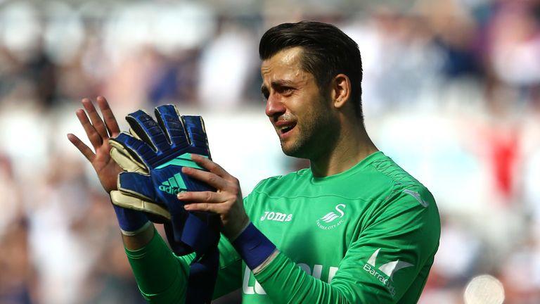 Swansea goalkeeper Lukasz Fabianski in tears after the side's relegation was confirmed