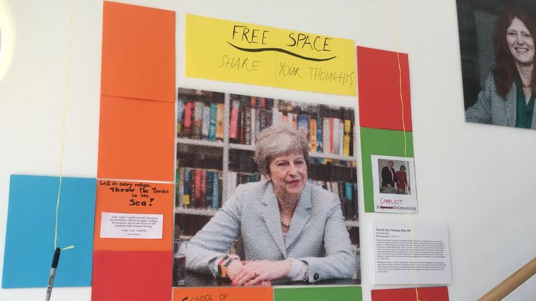 Students defaced the portrait of Mrs May, included in a display of 12 important Oxford geographers