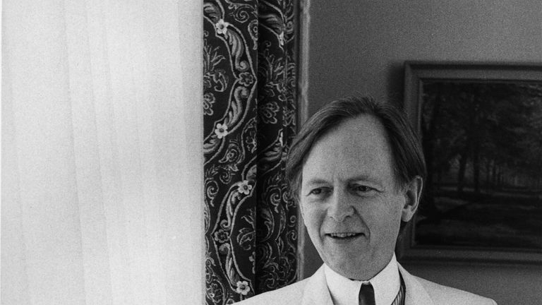 Tom Wolfe seen in his usual dapper white suit