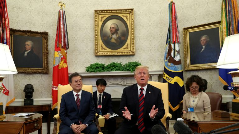 U.S. President Donald Trump welcomes South Korea's President Moon Jae-In in the Oval Office of the White House in Washington, U.S., May 22, 2018.
