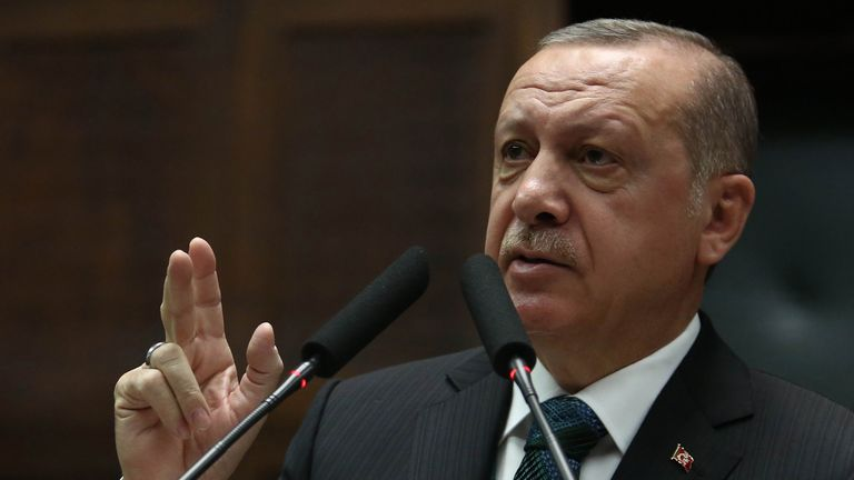 Turkish President and leader of the Justice and Development Party (AK Party) Recep Tayyip Erdogan gestures as he delivers a speech during the AK Party's parliamentary group meeting at the Grand National Assembly of Turkey (TBMM) in Ankara on March 20, 2018. / AFP PHOTO / ADEM ALTAN (Photo credit should read ADEM ALTAN/AFP/Getty Images)