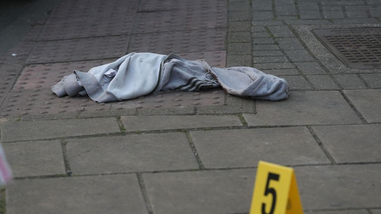 A hooded top was left on the pavement near one of the crime scenes