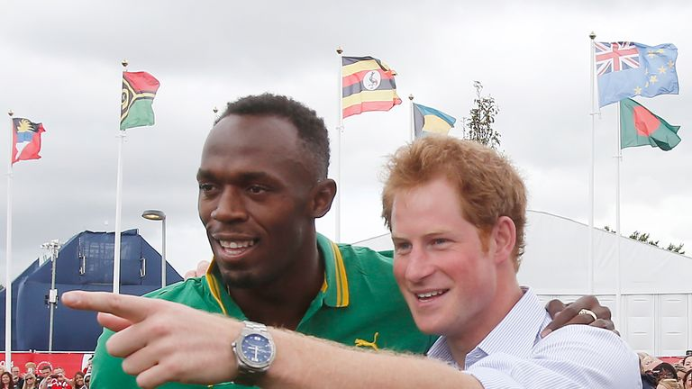 Prince Harry and runner Usain Bolt pictured in 2014