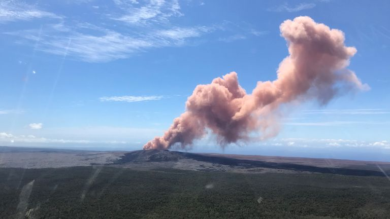 A plume of ash rises from Kilauea Volcano, one of five on the island, after a series of earthquakes