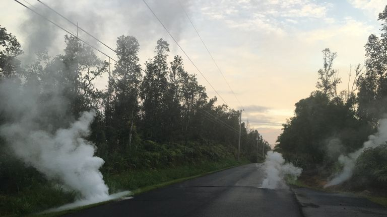 Steam cracks are shown before a fissure opened on Kaupili Street in the Leilani Estates