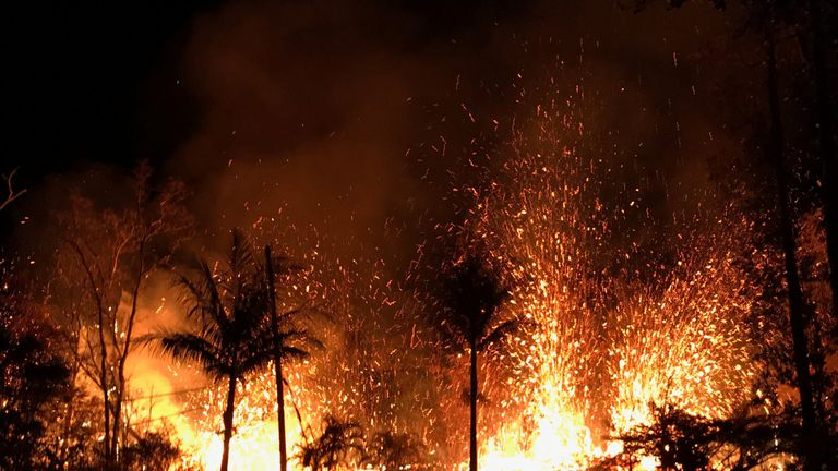 HAWAII-VOLCANO/RTS1Q3CD6 May. 2018UNITED STATESA new fissure spraying lava fountains as high as about 230 feet (70 m), according to United States Geological Survey, is shown from Luana Street in Leilani Estates subdivision on Kilauea Volcano's lower East Rift Zone in Hawaii, U.S., May 5, 2018. Photo taken May 5, 2018. US Geological Survey/Handout via REUTERS ATTENTION EDITORS - THIS IMAGE WAS PROVIDED BY A THIRD PARTY.