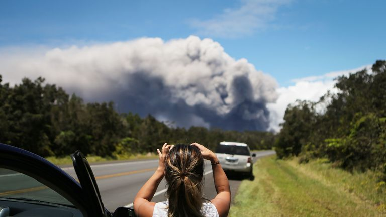 A massive plume of ash rises from the volcano