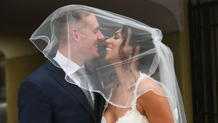 Vicky Compson and Aron Hallam outside Windsor Guildhall following their wedding
