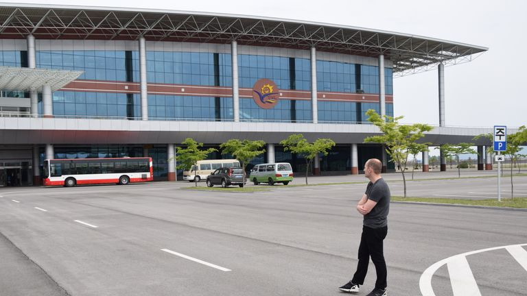 Sky News Asia correspondent Tom Cheshire looks at Kalma Airport in Wonsan. Pic: Michael Greenfield