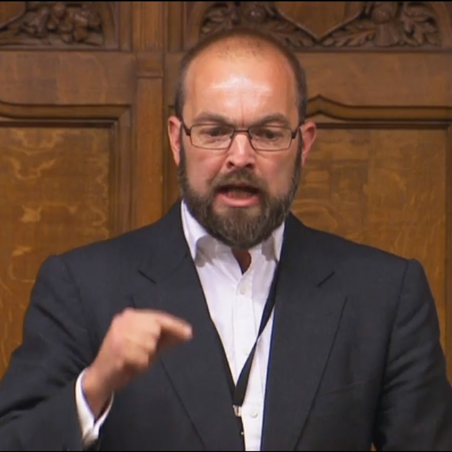 James Duddridge Conservative MP for the constituency of Rochford and Southend East, in Essex, does not wear a tie as he asks a question during Prime Minister's Questions in the House of Commons, London.