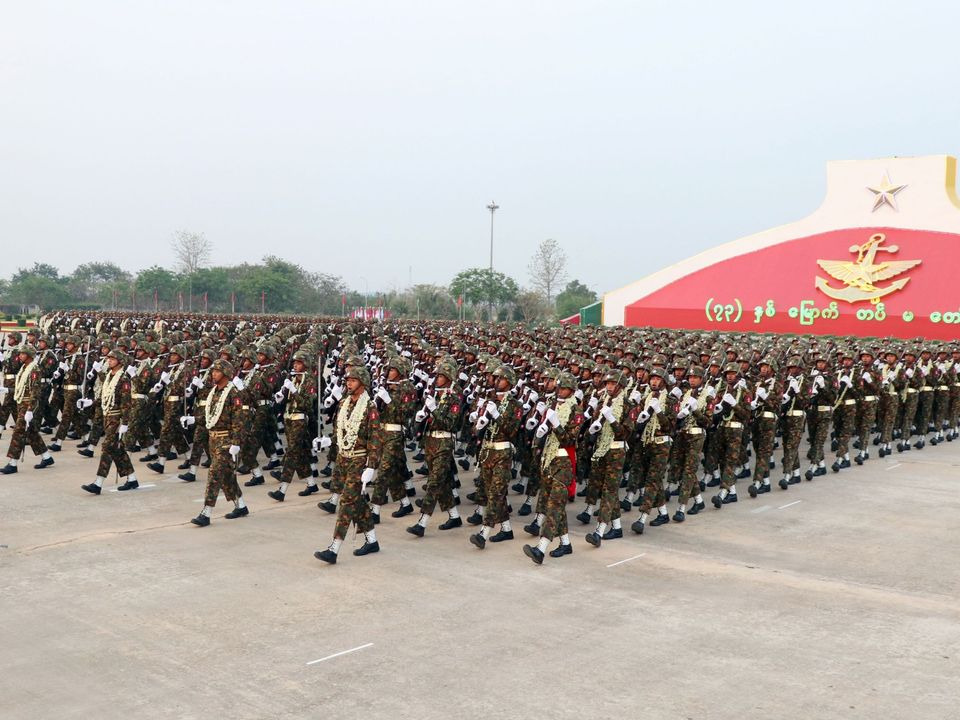 Myanmar soldiers march in formation during a military parade in Naypyidaw on March 27, 2018 to mark the 73rd Armed Forces Day. / AFP PHOTO / Thet AUNG (Photo credit should read THET AUNG/AFP/Getty Images)