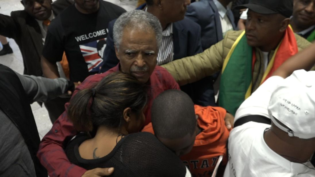 Andy Tsege being greeted at Heathrow Airport