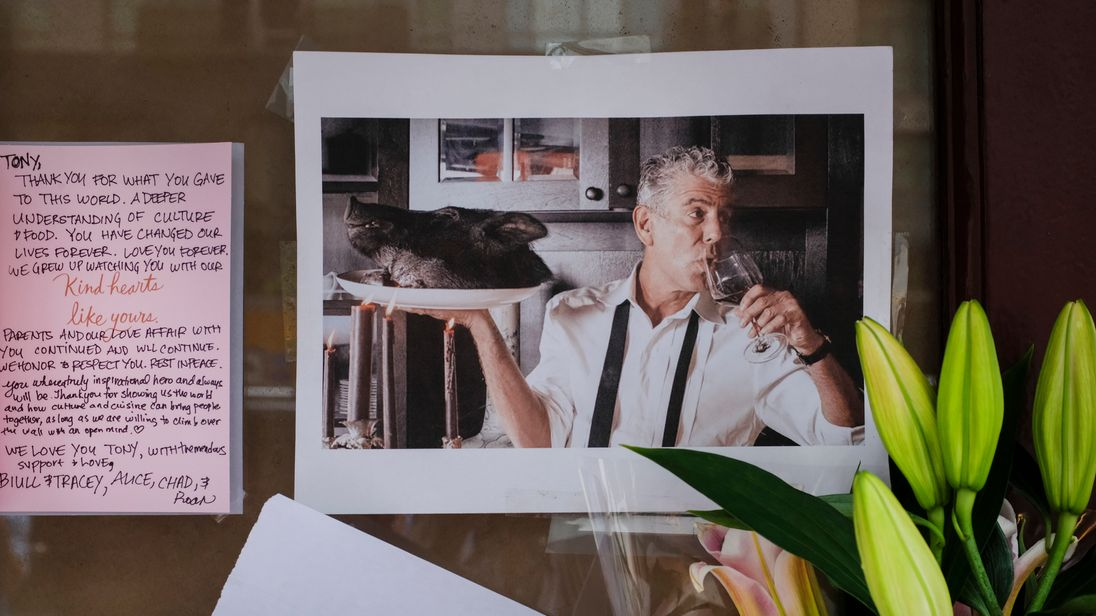 Notes, photographs and flowers are left in memory of Anthony Bourdain