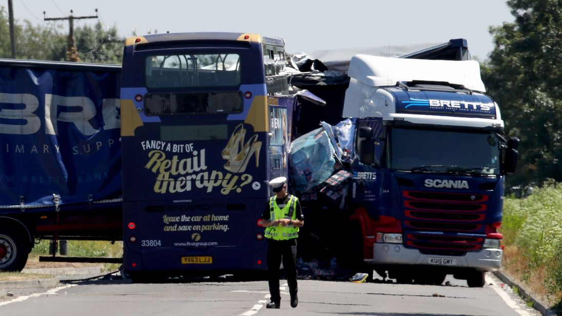two killed in lorry and bus crash on a47 in cambridgeshire