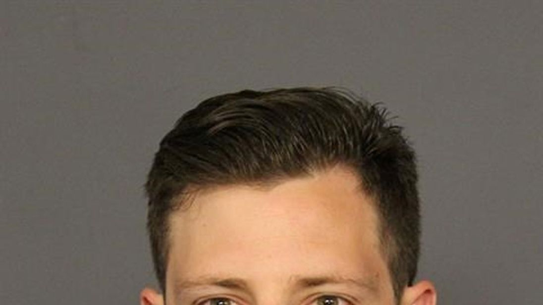 FBI agent Chase Bishop appears in a booking photo released by the Denver District Attorney's Office