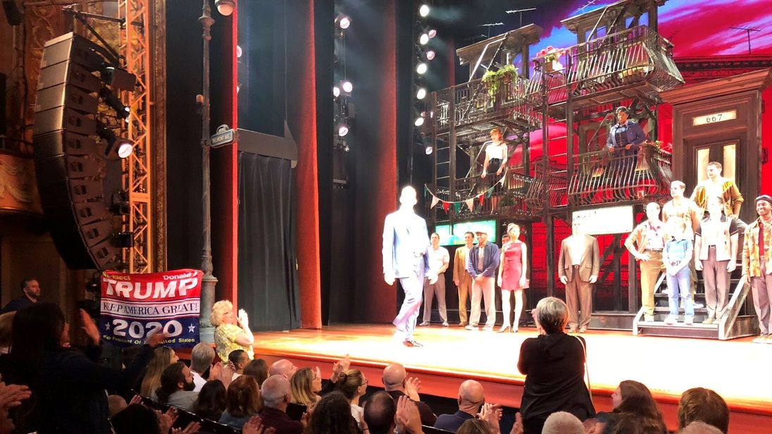 Theatergoer Holds Up 'Trump 2020' Flag At Robert De Niro's 'Bronx Tale'