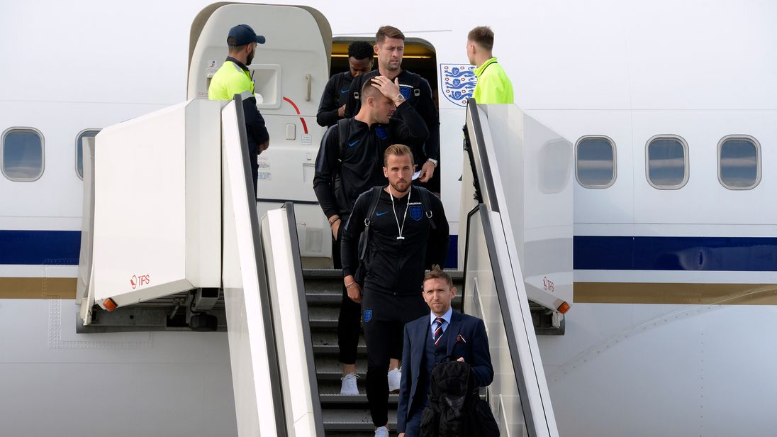 England captain Harry Kane (C) and teammates arrive at Saint Petersburg's Pulkovo airport