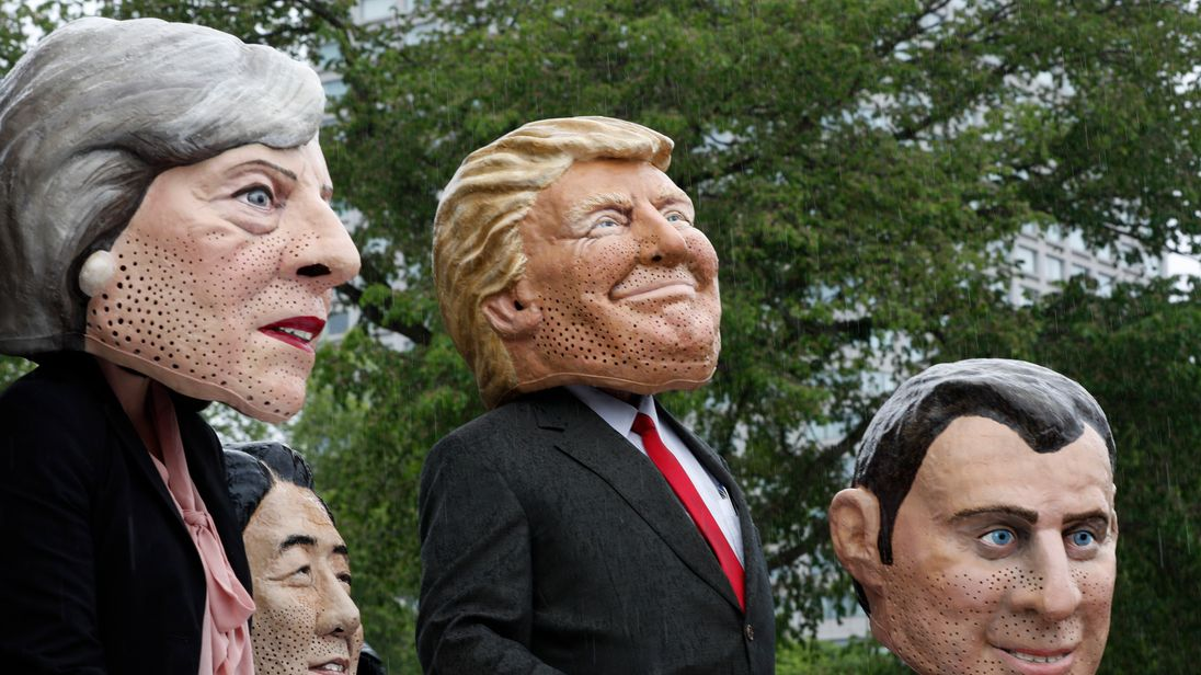 Members of OXFAM dressed as the G7 leaders pose for pictures outside the Quebec provincial building ahead of the G7 summit in Quebec City, Quebec, June 7, 2018