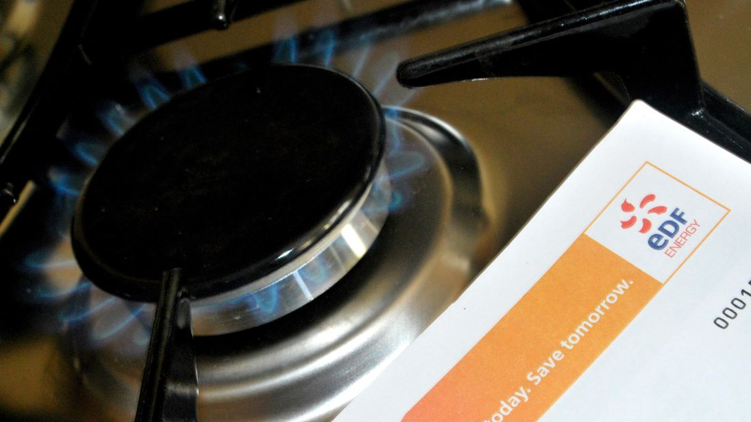A generic view of an EDF Energy letter in front of a gas cooker flame
