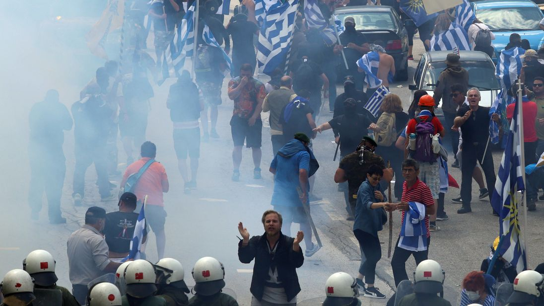A man faces riot police in Pisoderi near the border with Macedonia