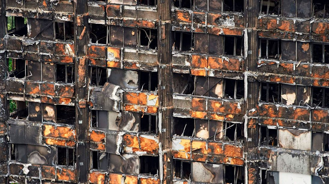 The charred remains of clading are pictured on the outer walls of the burnt out shell of the Grenfell Tower block in north Kensington, west London on June 22, 2017